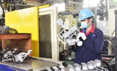 Sunrise Metal Employee Inspecting Quality of a Die Casting Part