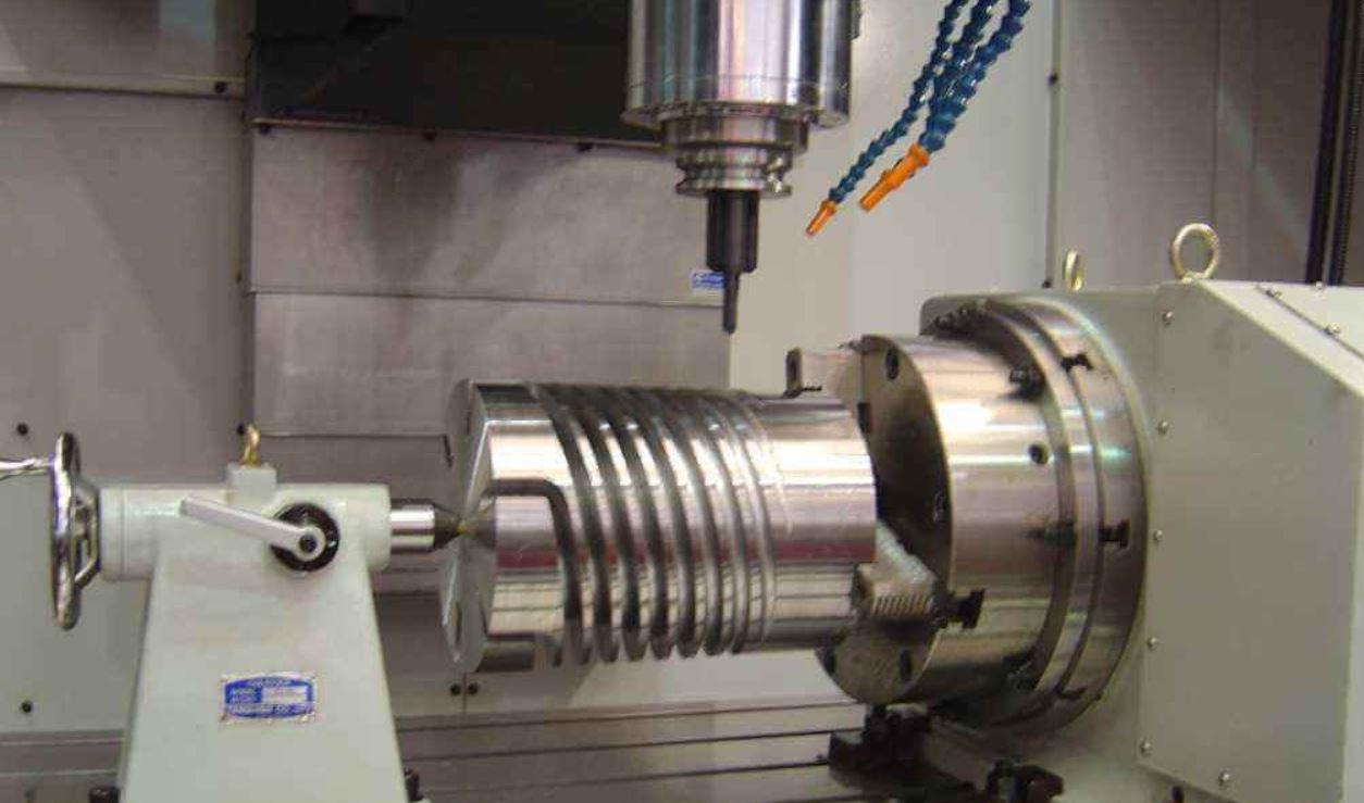 Simultaneous (True) four axis CNC Machining Center